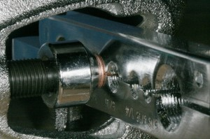 Install the wedge and screw on the flaring tool, and drive the wedge into the end of the tube to flare it.